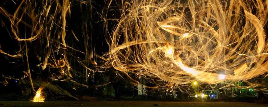fire spinning at purple lotus kava bar.