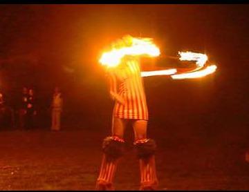 Fire Spinning On Stilts